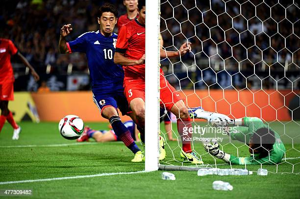 Mohamad Izwan Bin Mahbud of Singapore saves the ball on the line during the 2018 FIFA World Cup Asian Qualifier second round match between Japan and...