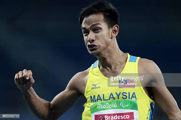 Mohamad Ridzuan Puzi of Malaysia reacts after the victory in the men's 100 meter T36 Final on day 3 of the Rio 2016 Paralympic Games on September 10...