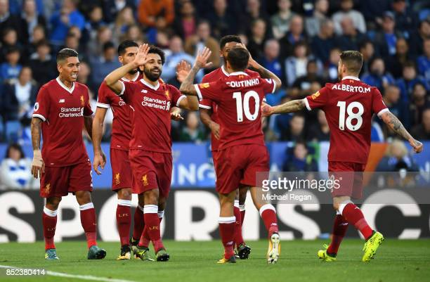 Mohamad Salah of Liverpool celebrates after scoring his sides first goal during the Premier League match between Leicester City and Liverpool at The...