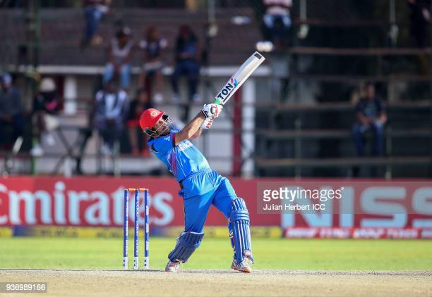 Mohamad Stanikzai of Afghanistan scores runs during The ICC Cricket World Cup Qualifier between Ireland and Afghanistan at The Harare Sports Club on...