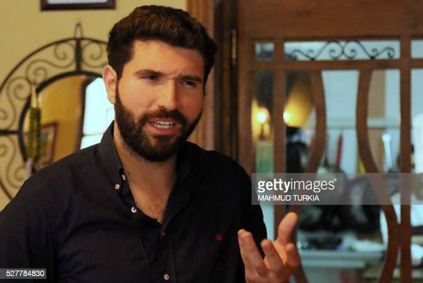 Mohamad Twigiri the owner of the Naranj restaurant in Tripoli gives an interview with AFP on April 11 after he reopened his restaurant a couple of...
