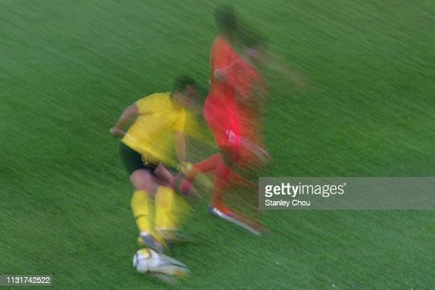 Mohamad Zaquan of Malaysian controls the ball during the Airmarine Cup match between Malaysia and Singapore at Bukit Jalil National Stadium on March...