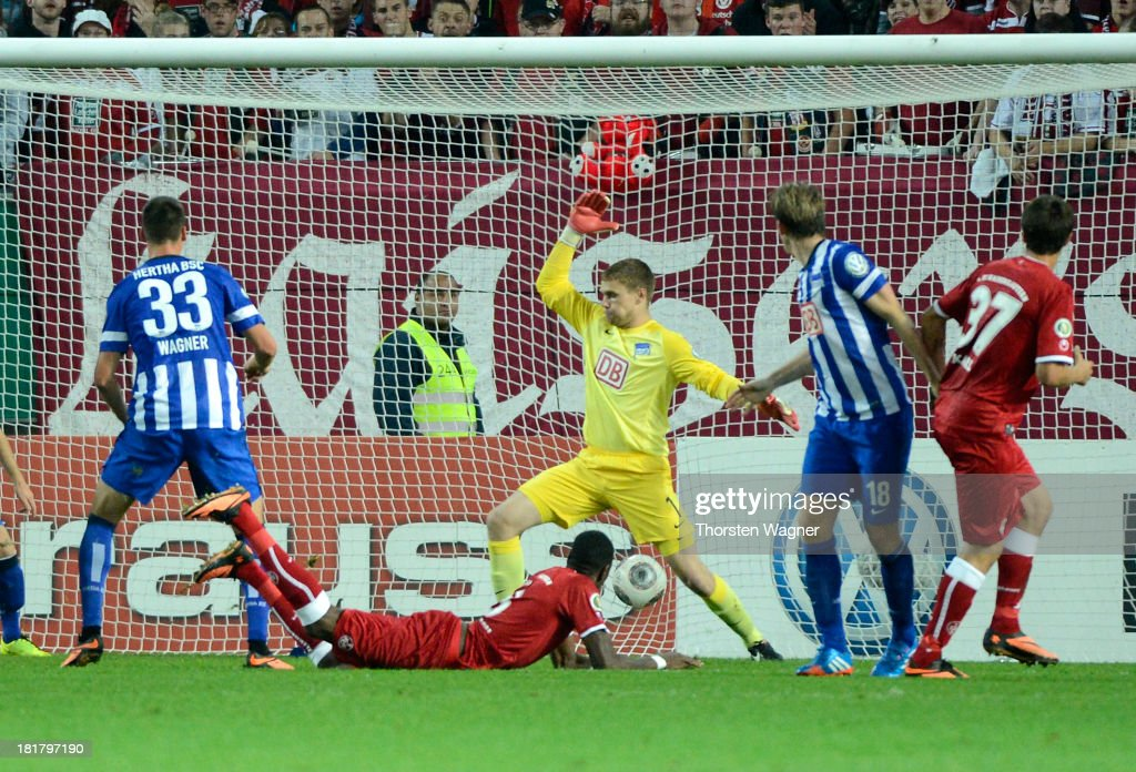 Mohamadou Idrissou is scoring his teams first goal during the DFB Cup 2nd round match between 1.FC Kaiserslautern and Hertha BSC Berlin at Fritz-Walter-Stadion on September 25, 2013 in Kaiserslautern, Germany.