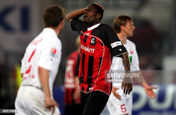 Mohamadou Idrissou of Freiburg despairs after missing a chance at goal as Marcel Busch and Ole Kittner of Ahlen react during the Second Bundesliga...