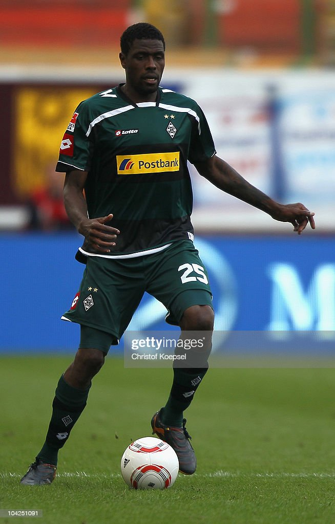 Mohamadou Idrissou of Gladbach runs with the ball during the Bundesliga match between VfB Stuttgart and Borussia Moenchengladbach at Mercedes-Benz Arena on September 18, 2010 in Stuttgart, Germany.