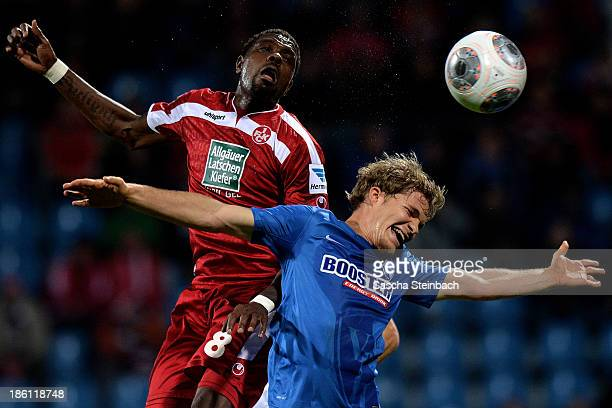 Mohamadou Idrissou of Kaiserslautern and Florian Jungwirth of Bochum battle for a header during the Second Bundesliga match between VfL Bochum and 1...