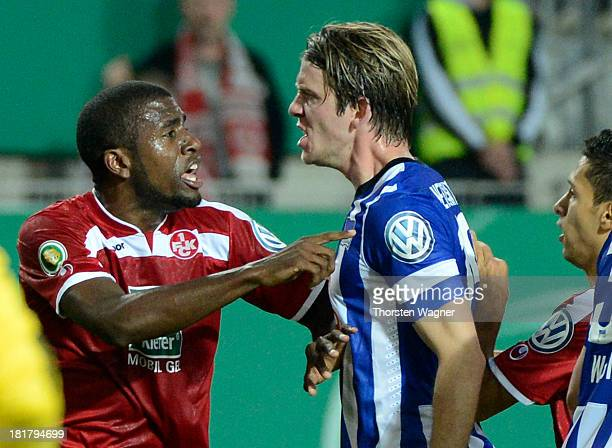Mohamadou Idrissou of Kaiserslautern in action with Peter Niemeyer of Berlin during the DFB Cup 2nd round match between 1FC Kaiserslautern and Hertha...