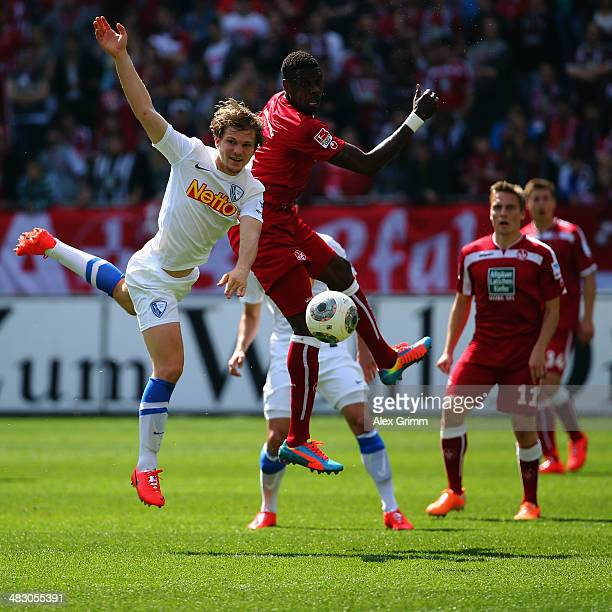 Mohamadou Idrissou of Kaiserslautern is challenged by Florian Jungwirth of Bochum during the Second Bundesliga match between 1 FC Kaiserslautern and...
