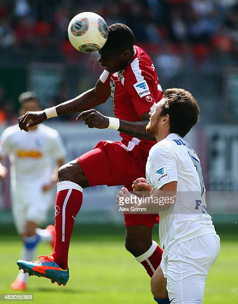Mohamadou Idrissou of Kaiserslautern is challenged by Paul Freier of Bochum during the Second Bundesliga match between 1 FC Kaiserslautern and VfL...