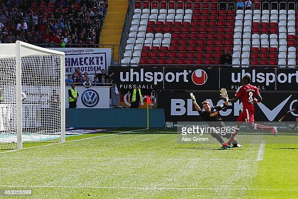 Mohamadou Idrissou of Kaiserslautern scores his team's first goal against goalkeeper Andreas Luthe of Bochum during the Second Bundesliga match...