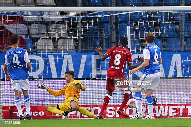 Mohamadou Idrissou of Kaiserslautern scores the second goal against Marcel Maltritz Andreas Luthe and Lukas Sinkiewicz of Bochum during the Second...