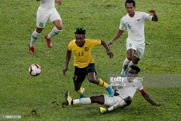 Mohamadou Sumareh of Malaysia clashes with Rudolof Yanto Basna of Indonesia during the 2022 Qatar FIFA World Cup Asian qualifier group G match...