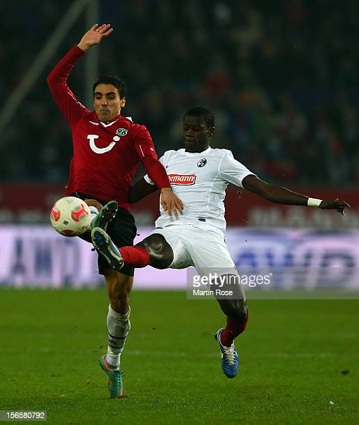 Mohamed Abdellaoue of Hannover and Fallou Diagne of Freiburg battle for the ball during the Bundesliga match between Hannover 96 and SC Freiburg at...