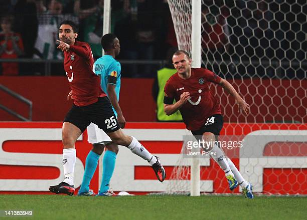 Mohamed Abdellaoue of Hannover celebrates after scoring his team's first goal during the UEFA Europa League second leg round of 16 match between...