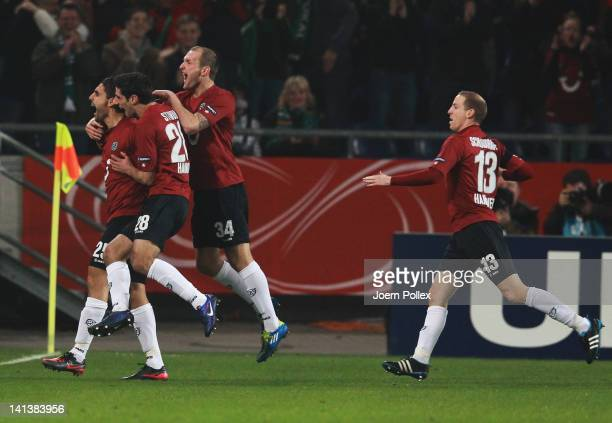 Mohamed Abdellaoue of Hannover celebrates with his team mates after scoring his team's first goal during the UEFA Europa League second leg round of...