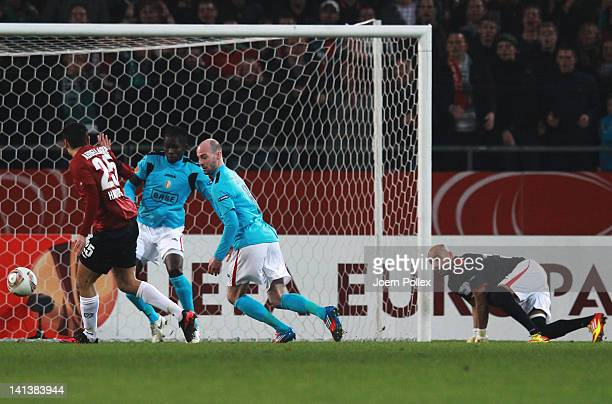 Mohamed Abdellaoue of Hannover scores his team's first goal during the UEFA Europa League second leg round of 16 match between Hannover 96 and...