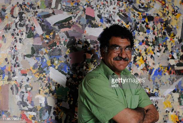 Mohamed Abla one of Egypt's most esteemed contemporary artists stands in front of a painting in his downtown Cairo studio that was inspired by recent...