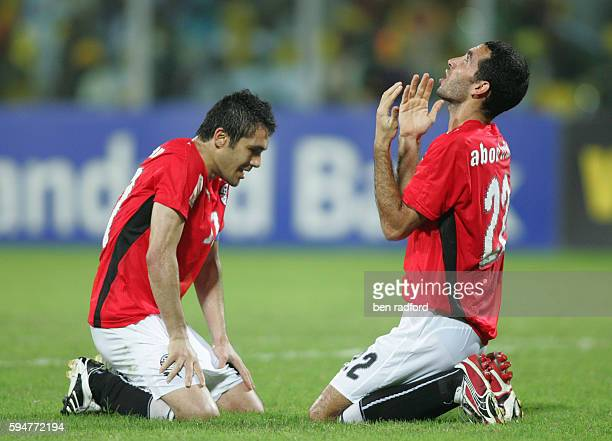 Mohamed Abouterika of Egypt celebrates scoring the winning goal with Captain Ahmed Fathy Abdel Meneim during the Final of the 2008 African Cup of...