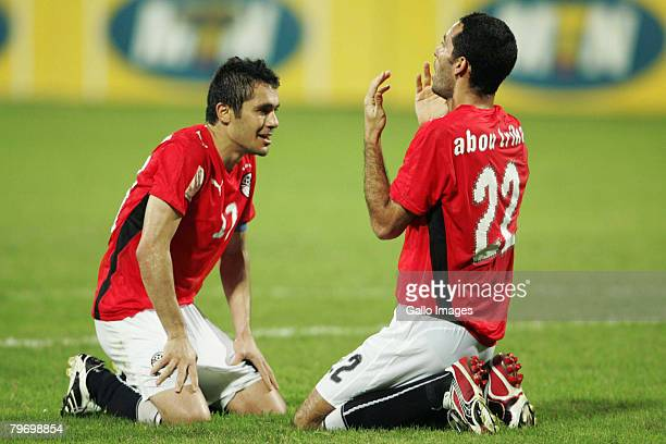 Mohamed Aboutriaka celebrates his goal with Egypt teammate Ahmed Hassan Kamel during the AFCON Final match between Cameroon and Egypt at the Ohene...