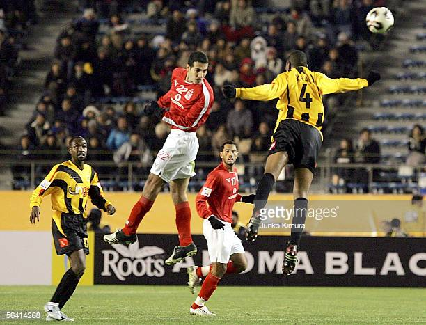 Mohamed Aboutrika of Al Ahly and Redha Tukar of Al Ittihad in action during the FIFA Club World Championship Toyota Cup Japan 2005 the first round...