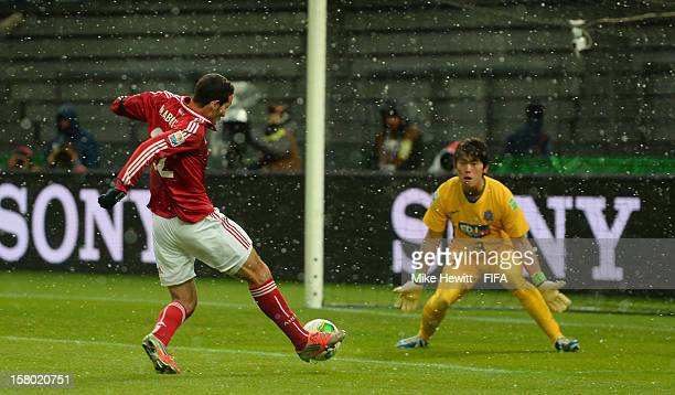 Mohamed Aboutrika of AlAhly slots the ball past Shusaku Nishikawa of Sanfrecce Hiroshima during the FIFA Club World Cup Quarter Final match between...