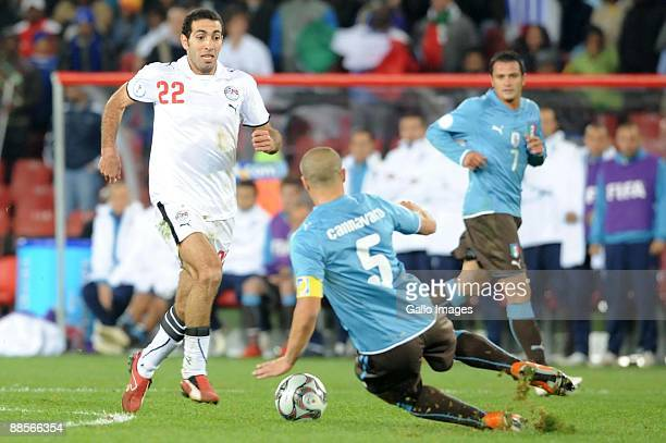 Mohamed Aboutrika of Egypt and Fabio Cannavaro of Italy battle for the ball during the 2009 Confederations Cup match between Egypt and Italy at...