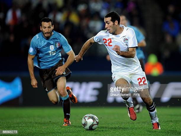 Mohamed Aboutrika of Egypt goes past Gianluca Zambrotta of Italy during the FIFA Confederations Cup Group A match between Egypt and Italy at the...
