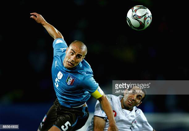 Mohamed Aboutrika of Egypt tackles Fabio Cannavaro of Italy during the FIFA Confederations Cup match between Egypt and Italy at Ellis Park Stadium on...