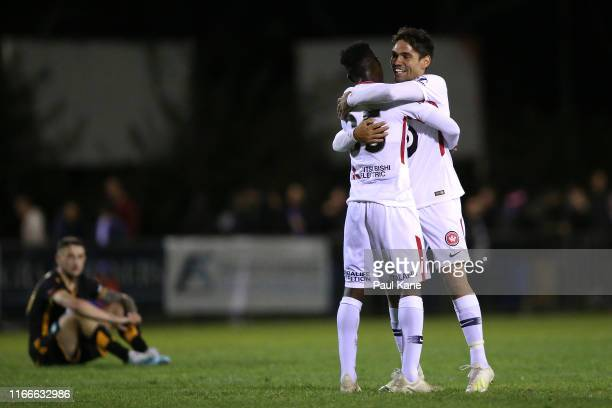 Mohamed Adam and Tate Russell of the Wanderers celebrate winning the FFA Cup Round of 32 match between Perth Glory and the Western Sydney Wanderers...