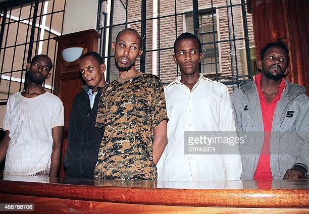 Mohamed Adan Surow Osman Abdi Dakane Mohamed Abdi Abikar Hassan Aden Hassan and Sahal Diriye Hussein stand in the Milimani Law Courts in Nairobi on...