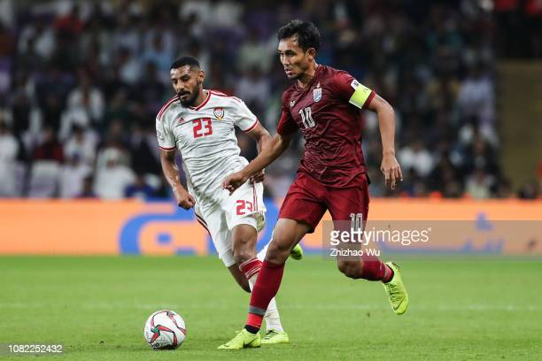 Mohamed Ahmad Gharib of United Arab Emirates competes with Teerasil Dangda of Thailand during the AFC Asian Cup Group A match between the United Arab...