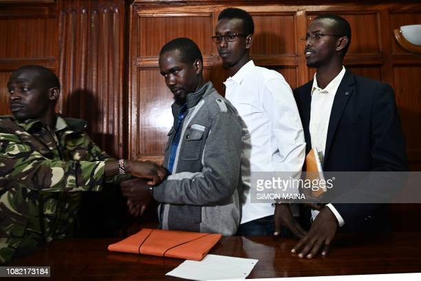 Mohamed Ahmed Abdi Adan Mohamed Ibrahim and Hussein Hassan Mustafah appear at the Milimani High Court in Nairobi on January 14 2019 in connection...