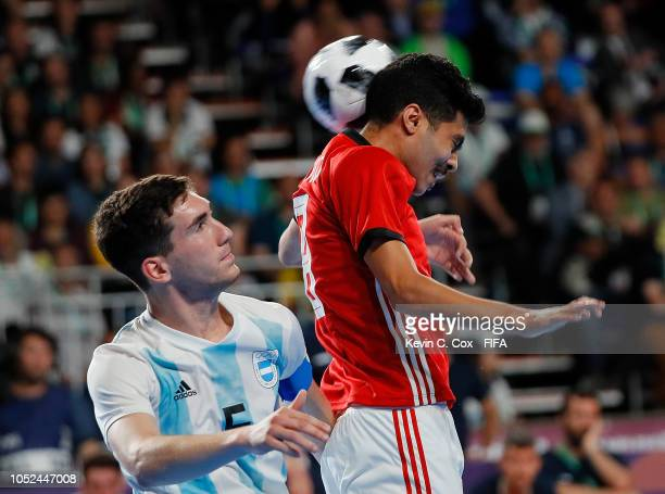Mohamed Ahmed of Egypt attempts a shot on goal with a header against Facundo Gassman of Argentina in the Men's Futsal 3rd Place match between Egypt...