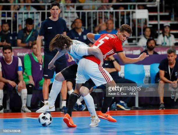 Mohamed Ahmed of Egypt challenges Agustin Raggiati of Argentina in the Men's Futsal 3rd Place match between Egypt and Argentina during the Buenos...