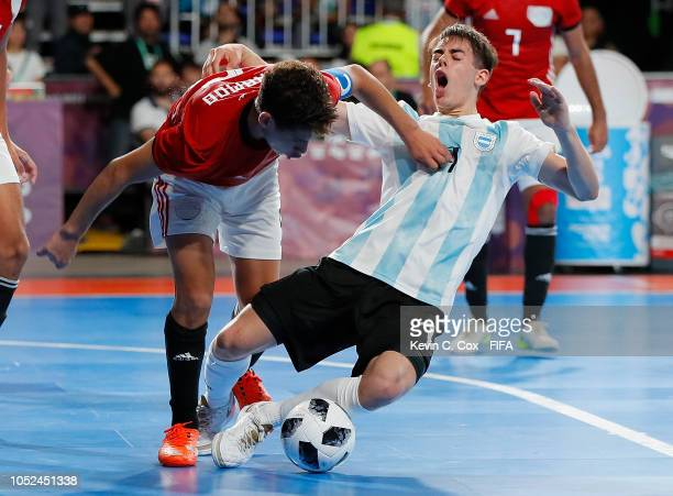 Mohamed Ahmed of Egypt challenges Ezequiel Ramirez of Argentina in the Men's Futsal 3rd Place match between Egypt and Argentina during the Buenos...