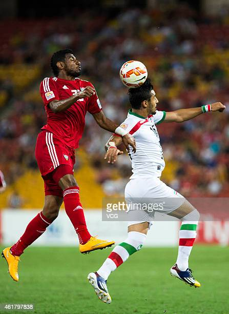 Mohamed Ahmed of the United Arab Emirates and Reza Ghoochannejhad of Iran compete for the ball during the 2015 Asian Cup match between IR Iran and...