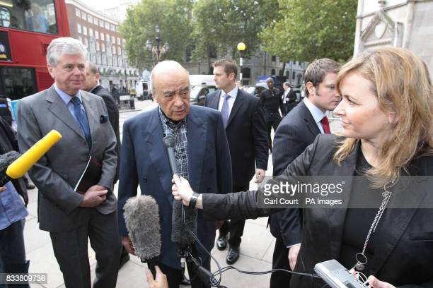 Mohamed al Fayed with his assistant Michael Cole arriving at the High Court in London on the third day of the inquest into the death of his son Dodi...