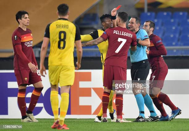 Mohamed Ali Camara of BSC Young Boys is shown a red card by referee Fran Jovic as Lorenzo Pellegrini of Roma argues with him during the UEFA Europa...