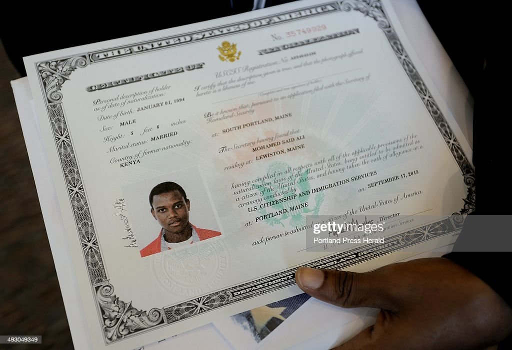 Mohamed Ali, 19, of Lewiston, originally of Kenya, holds his ...