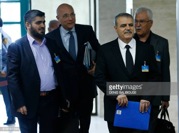 Mohamed Alloush of the Jaish alIslam UN Deputy Special Envoy for Syria Ramzy Ezzeddine Ramzy Asaad AlZoubi and George Sabra of the delegation of the...