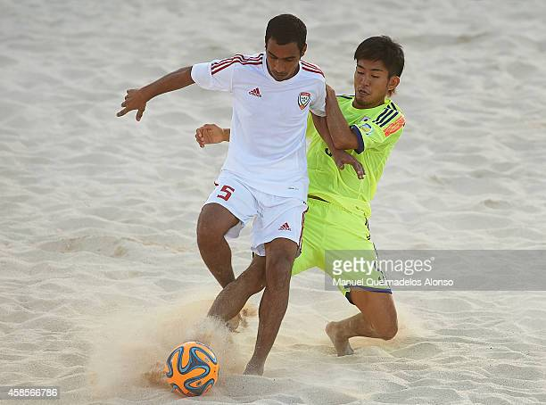 Mohamed Alzaabi of UAE competes for the ball with Shotaro Haraguchi of Japan during day fourth of the Beach Soccer Intercontinental Cup 2014 match...
