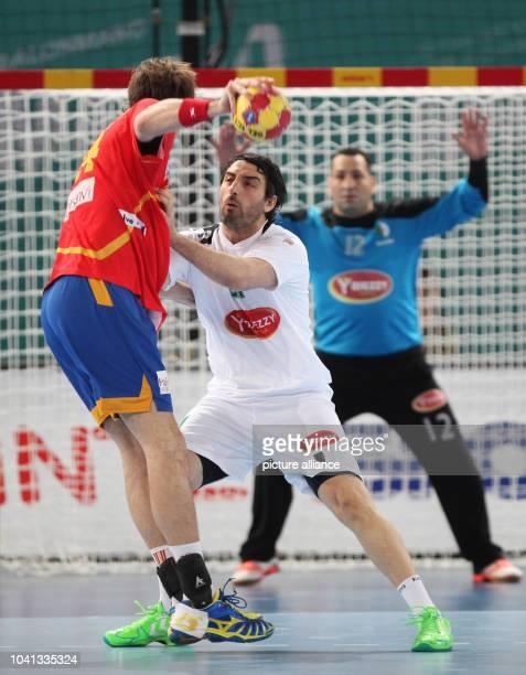 Mohamed Aski Mokrani of Algeria blocks Viran Morros de Argila of Spain during the men's Handball World Championships main round match Spain vs...