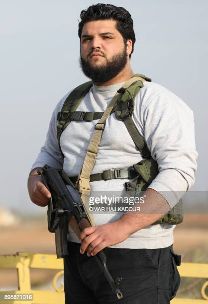 Mohamed Assaf a 22yearold Syrian rebel fighter who fled Aleppo when the city was recaptured by regime forces poses for a picture during an interview...