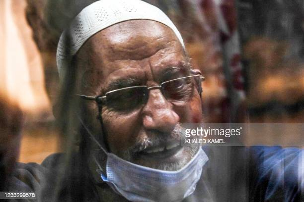 Mohamed Badie, current leader of Egypt's Muslim Brotherhood society, attends a trial session at the make-shift courtroom at the Torah Police...