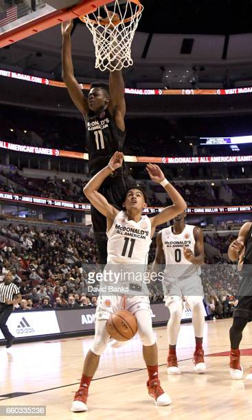 Mohamed Bamba boys east team defends Trae Young boys west team during the 2017 McDonalds's All American Game on March 29 2017 at the United Center in...