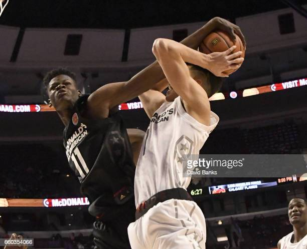 Mohamed Bamba of the boys east team blocks Michael Porter Jr #1 of the boys west team during the 2017 McDonalds's All American Game on March 29 2017...
