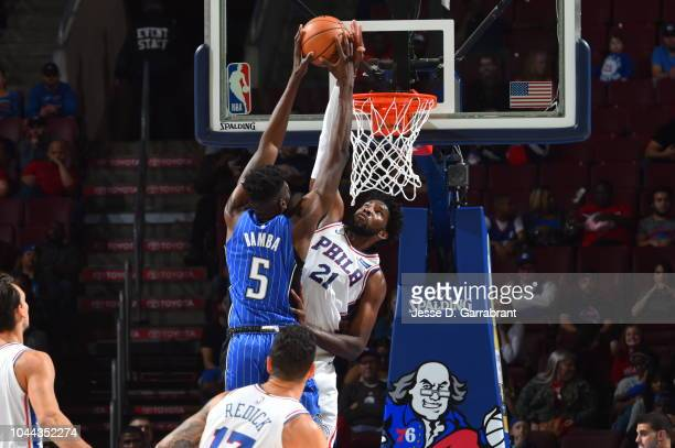 Mohamed Bamba of the Orlando Magic dunks the ball against Joel Embiid of the Philadelphia 76ers during a preseason game on October 1 2018 at the...