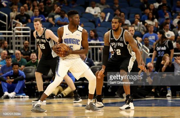 Mohamed Bamba of the Orlando Magic is defended by LaMarcus Aldridge of the San Antonio Spurs during a preseason game at Amway Center on October 12...