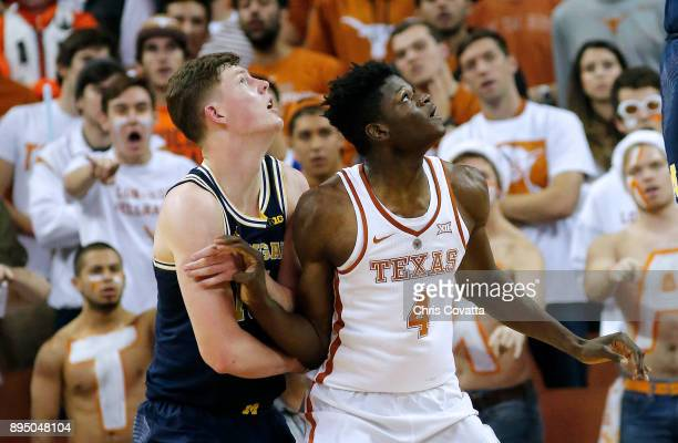 Mohamed Bamba of the Texas Longhorns and Jon Teske of the Michigan Wolverines battles for position at the Frank Erwin Center on December 12 2017 in...