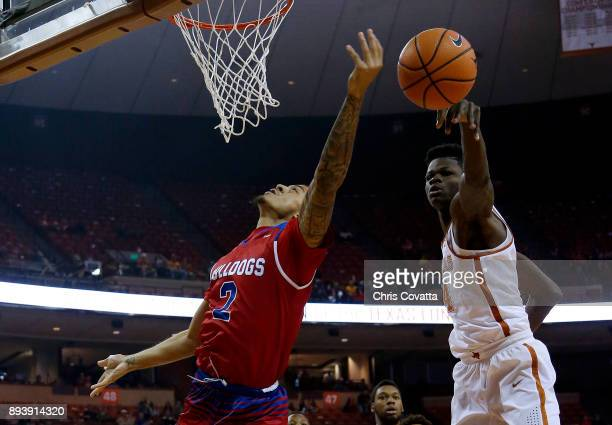 Mohamed Bamba of the Texas Longhorns blocks a shot by Jalen Harris of the Louisiana Tech Bulldogs at the Frank Erwin Center on December 16 2017 in...